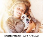 Smiling Child With Dog....