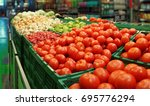 vegetables in a cash and carry... | Shutterstock . vector #695776294