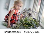 the little girl sits at a... | Shutterstock . vector #695779138