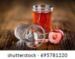 homemade cherry liqueur on an... | Shutterstock . vector #695781220