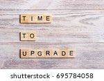 time to upgrade text on a... | Shutterstock . vector #695784058