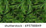 seamless palm trees leaves... | Shutterstock .eps vector #695788849