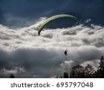 paraglider over sea of clouds... | Shutterstock . vector #695797048