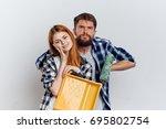 repair of an apartment  a woman ... | Shutterstock . vector #695802754