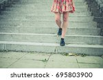 the legs of a young woman as... | Shutterstock . vector #695803900