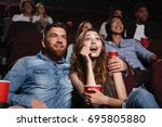 surprised young couple sitting... | Shutterstock . vector #695805880