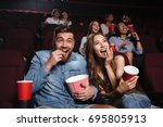 happy couple eating popcorn and ... | Shutterstock . vector #695805913