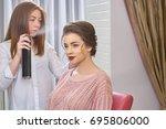 stylist using hair spray....   Shutterstock . vector #695806000