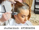 beautician dying hair of woman. ... | Shutterstock . vector #695806006