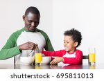 smiling african american father ...   Shutterstock . vector #695811013