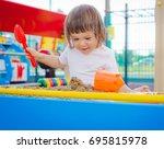 child in the sandbox | Shutterstock . vector #695815978