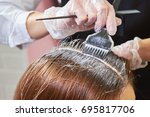 hair dying close up. brush... | Shutterstock . vector #695817706