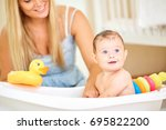 baby bathing in the bathroom... | Shutterstock . vector #695822200