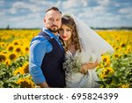happy bride and groom in... | Shutterstock . vector #695824399