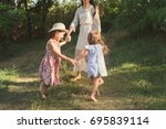 mother and her children playing ... | Shutterstock . vector #695839114