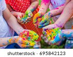 paint holi on the hands | Shutterstock . vector #695842123