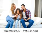 young parents sitting on the... | Shutterstock . vector #695851483