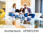 a young mixed race family... | Shutterstock . vector #695851534