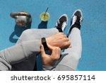 gym man touching smartwatch... | Shutterstock . vector #695857114