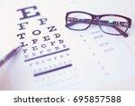 eye glasses and pen on eyesight ... | Shutterstock . vector #695857588
