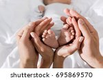 cropped view of parents holding ... | Shutterstock . vector #695869570