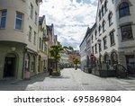 kongens gate in alesund in... | Shutterstock . vector #695869804