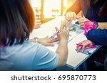 four businesswoman meeting and... | Shutterstock . vector #695870773