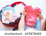 Pregnant Woman Packing Suitcas...