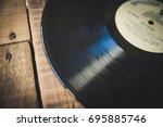 vinyl on wooden table  small... | Shutterstock . vector #695885746