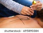 a woman is applying a henna...   Shutterstock . vector #695890384