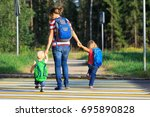 mother with two kids going to... | Shutterstock . vector #695890828