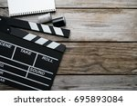 movie clapper on wood table  ... | Shutterstock . vector #695893084