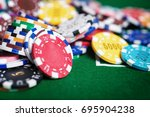 casino poker chips on the green ...   Shutterstock . vector #695904238
