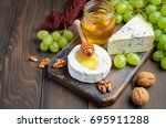 variety of cheese with grapes ... | Shutterstock . vector #695911288