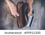 top view image of a man's hands ... | Shutterstock . vector #695911330