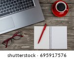 cup of coffee and laptop on...   Shutterstock . vector #695917576