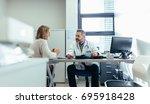 medical specialist discussing... | Shutterstock . vector #695918428