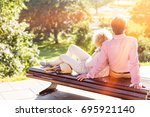 middle aged couple relaxing on...   Shutterstock . vector #695921140