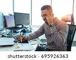 businessman talking on mobile... | Shutterstock . vector #695926363