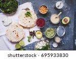 hummus pita bread with variety...   Shutterstock . vector #695933830