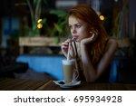 beautiful woman drinks a coffee ... | Shutterstock . vector #695934928