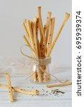 gressini breadsticks made of... | Shutterstock . vector #695939374
