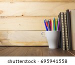 a cup of pencils   pens with... | Shutterstock . vector #695941558