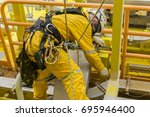 working at height. a commercial ... | Shutterstock . vector #695946400