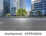 empty road with modern business ... | Shutterstock . vector #695946856