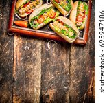 street food. hot dogs with... | Shutterstock . vector #695947186