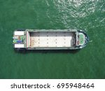 aerial view of cargo ship ... | Shutterstock . vector #695948464