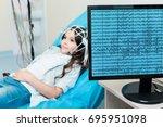 little girl having her brain... | Shutterstock . vector #695951098