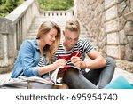 attractive teenage student...   Shutterstock . vector #695954740