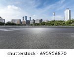 empty road with modern business ... | Shutterstock . vector #695956870